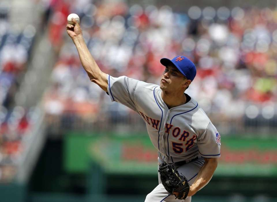 Carlos Torres delivers a pitch during the first