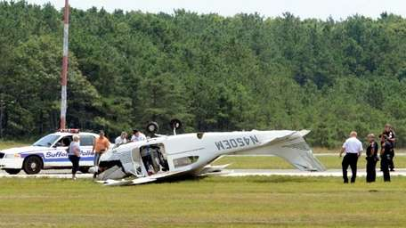 An overturned plane is seen at the Brookhaven