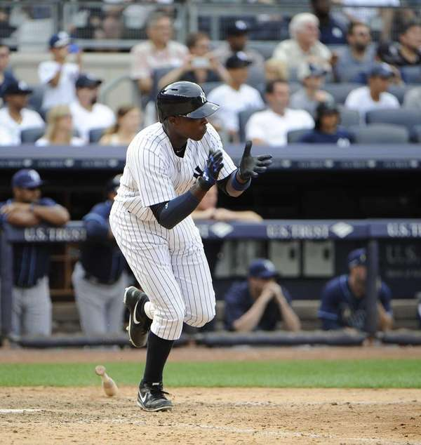 Alfonso Soriano reacts after he hitting a game-winning