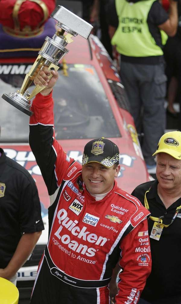 Ryan Newman celebrates after winning the Brickyard 400