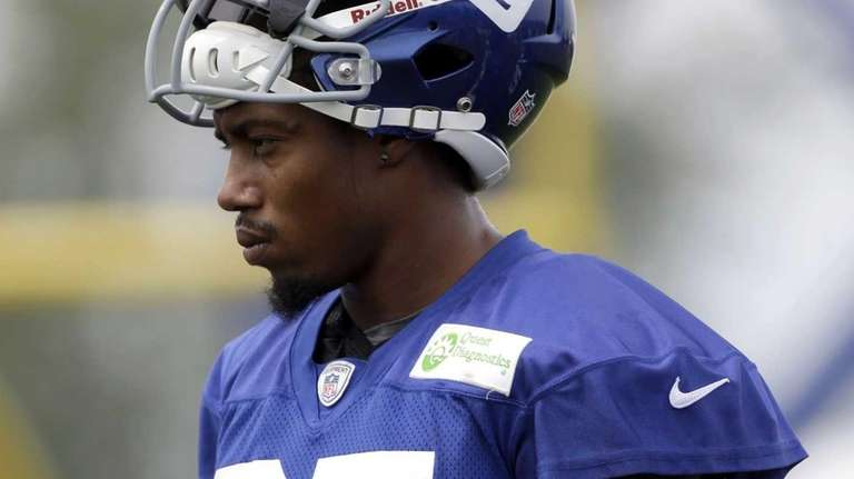 Giants defensive back Will Hill looks on during
