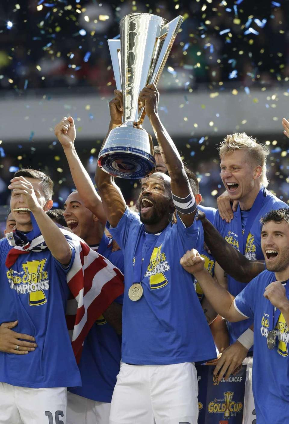 United States fullback DaMarcus Beasley, center, holds the