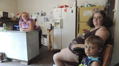 Irene Salyers, right, sits with here grandson Joseph,
