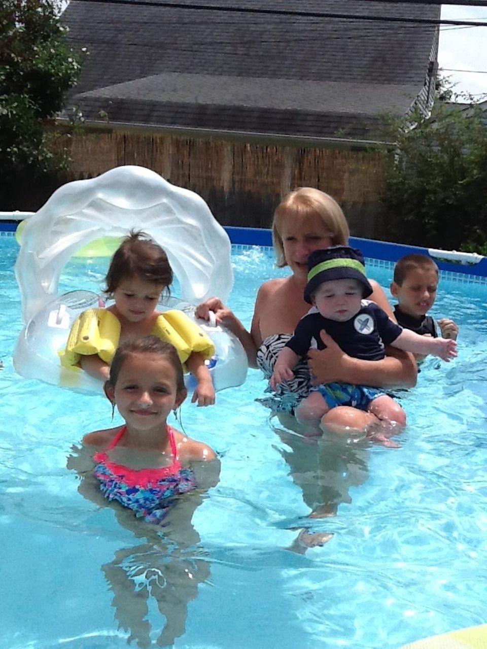 Dylan Champ Lyons swimming at Grandmas with his