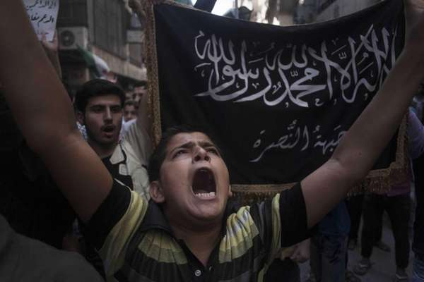 A Syrian boy shouts slogans against Bashar al-Assad