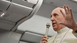 Pope Francis speaks during a press conference held