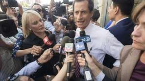 Democratic mayoral candidate Anthony Weiner is swarmed by