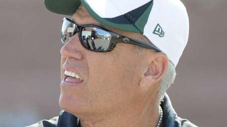 Jets head coach Rex Ryan looks on during
