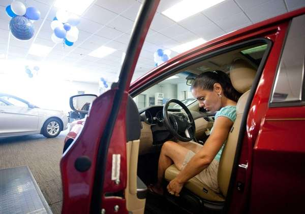 Rita Iannuzzi, of Smithtown, checks out a Hyundai