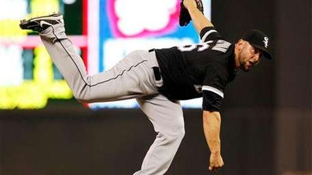 Chicago White Sox relief pitcher Jesse Crain delivers