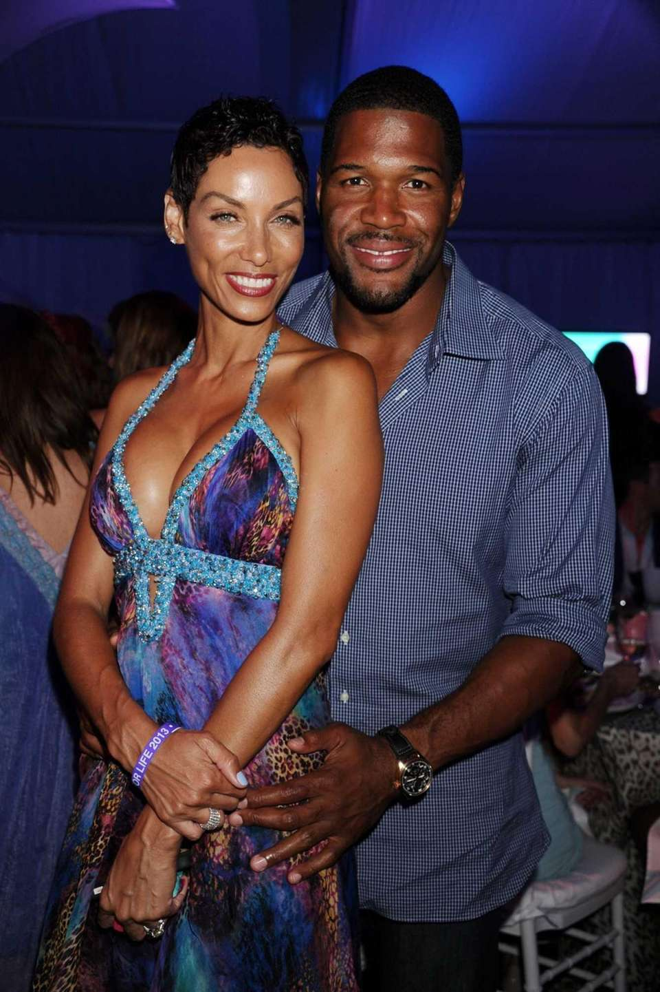 Nicole Murphy and Michael Strahan attend Russell Simmons'