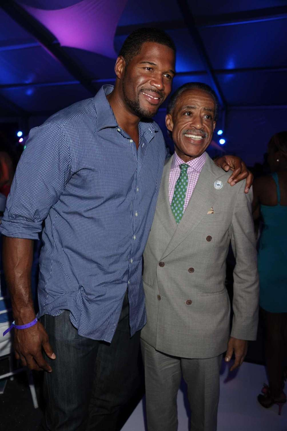 Michael Strahan and the Rev. Al Sharpton attend