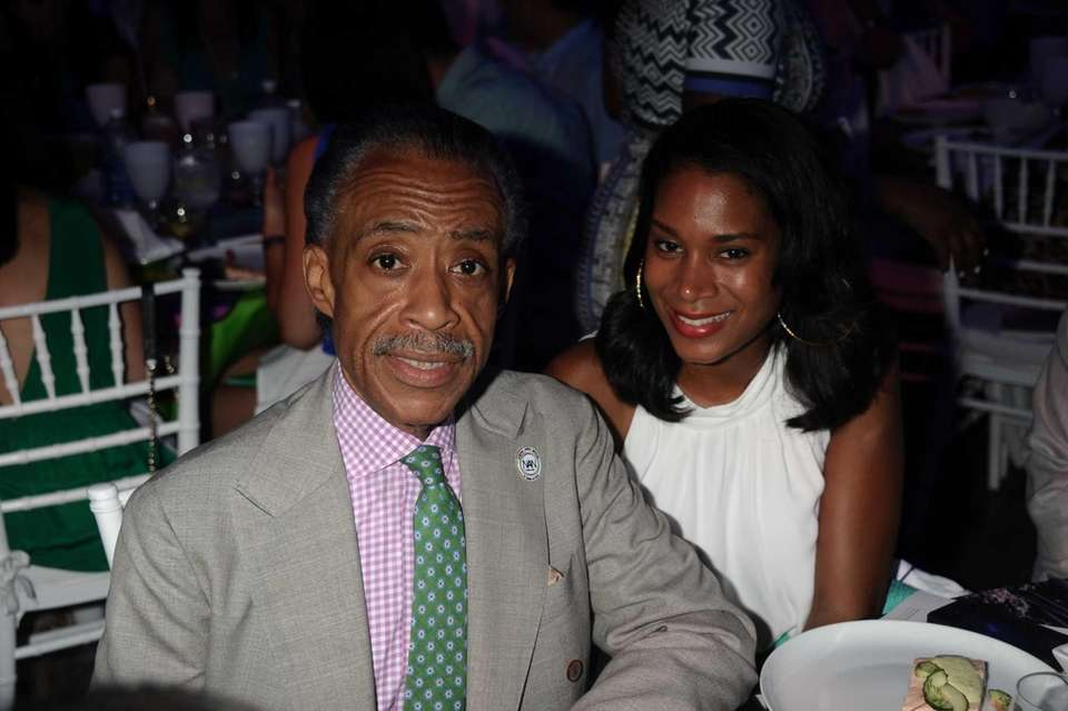 Reverand Al Sharpton and Aisha McShaw attend Russell