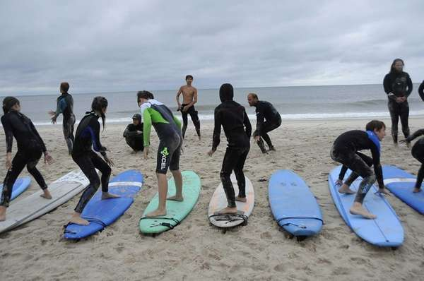 Students practice their surfing skills at a Southampton
