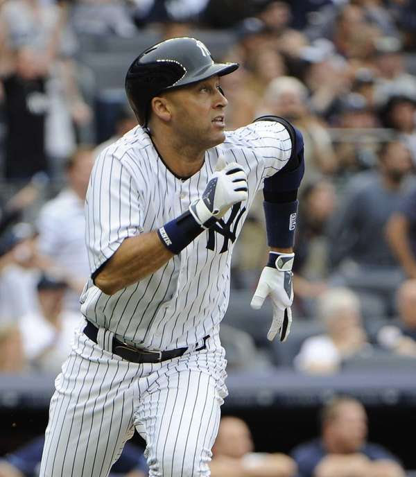 Derek Jeter watches his first-inning home run during
