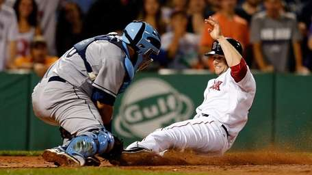 Tampa Bay Rays catcher Jose Molina tags out