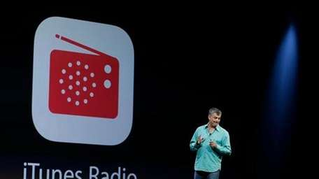 Apple executive Eddy Cue introduces the new iTunes