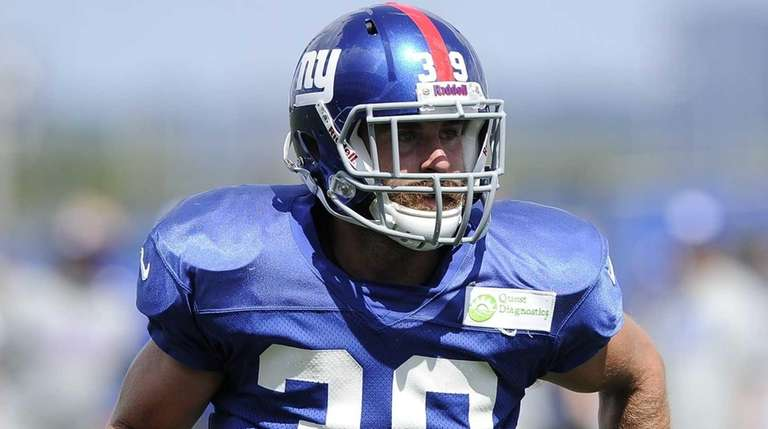 Giants safety Tyler Sash runs through a drill