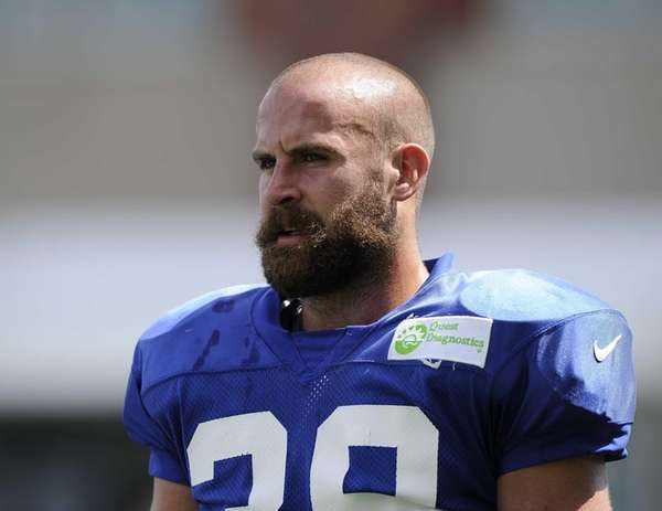 Giants safety Tyler Sash looks on during training