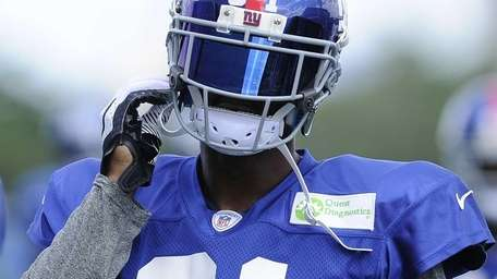 Aaron Ross looks on during training camp. (July
