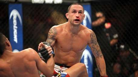 Frankie Edgar and Charles Oliveira fight in a