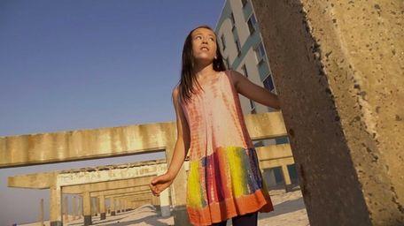 Jessie Faith Yoo, 11, of Garden City, shoots