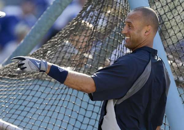 Derek Jeter smiles during batting practice before a