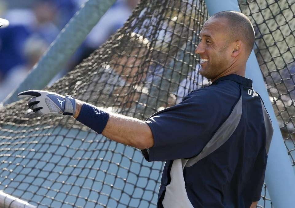 Derek Jeter smiles during batting practice before a
