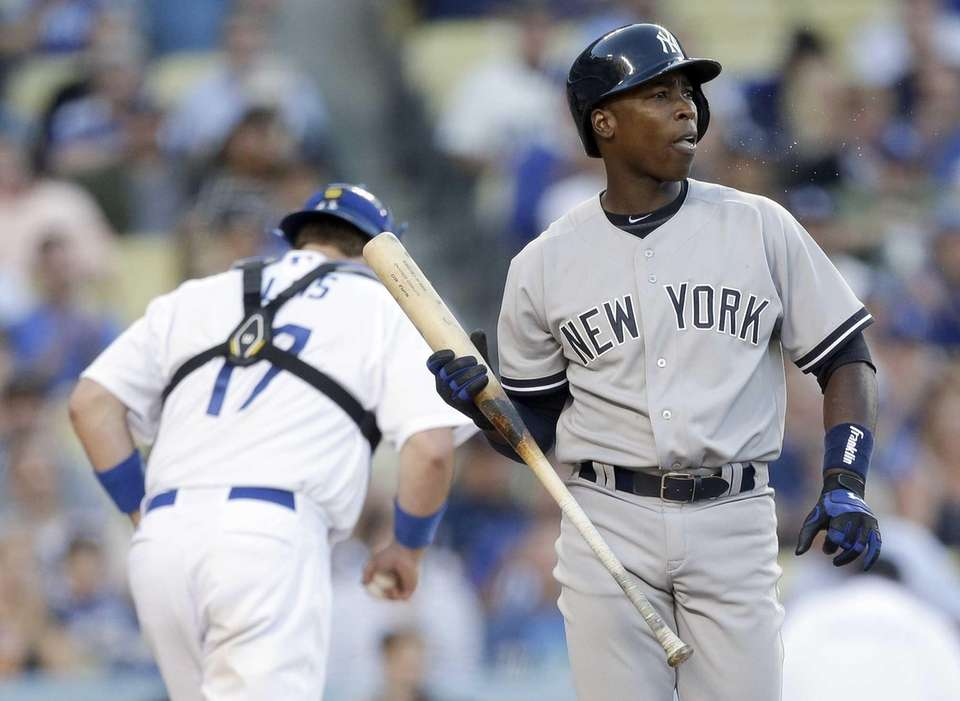 Yankees' Alfonso Soriano, right, reacts after striking out