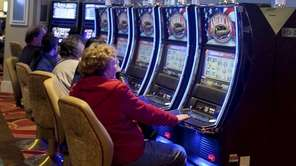 Guests play slot machines at the new Resorts