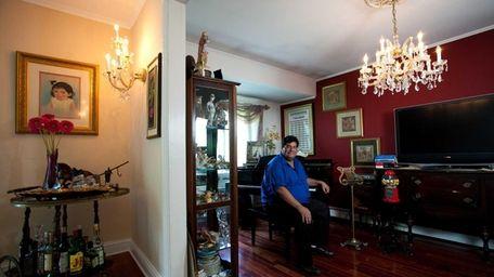 Paul Gastaldo shows the family room of his