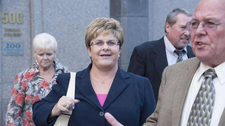 Marie Baran, second from left, exits Federal Court