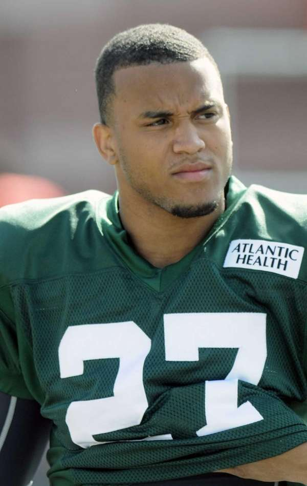 Dee Milliner of the Jets watches practice during