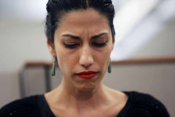 Huma Abedin, wife of Anthony Weiner, listens as