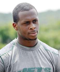 Jets quarterback Geno Smith talks with reporters during