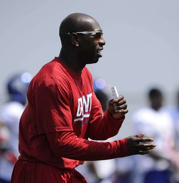 Giants coaching intern Sam Madison observes action during