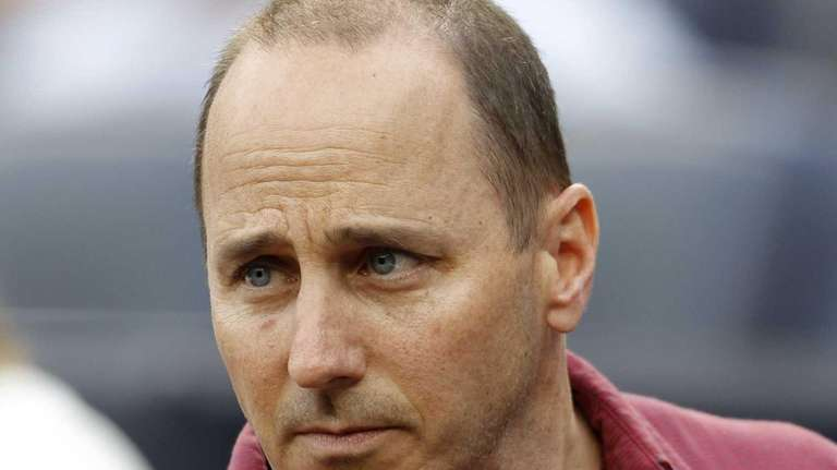 Brian Cashman is seen before the start of