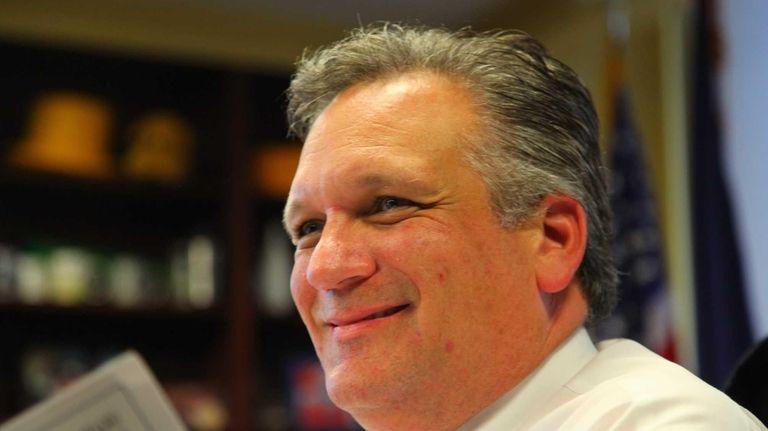 Nassau County Executive Edward Mangano looks over his