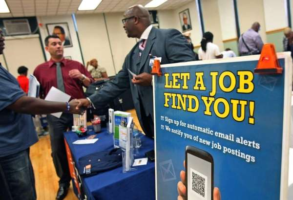 Job seekers attend a fair in Illinois.The Fed