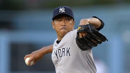Yankees starting pitcher Hiroki Kuroda throws to the