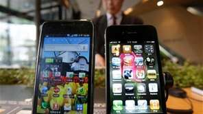 Samsung Electronics' Galaxy S, left, and Apple's iPhone