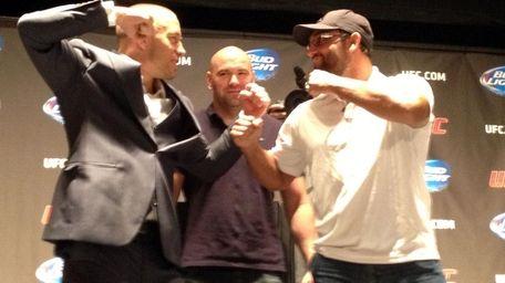 Welterweight champion Georges St-Pierre and challenger Johny Hendricks