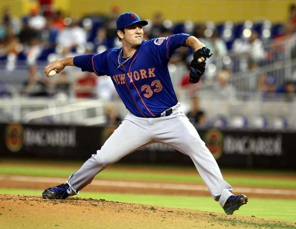 Matt Harvey of the Mets throws against the
