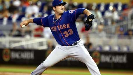 Matt Harvey of the Mets throws against the