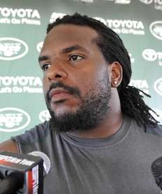 New York Jets guard Willie Colon talks with