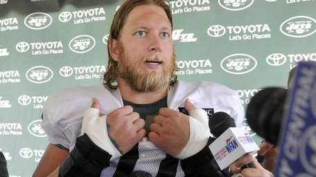 Jets center Nick Mangold talks with reporters during