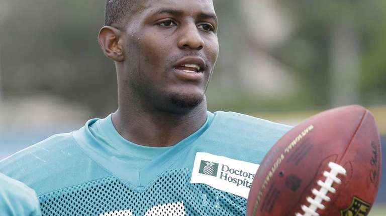 Miami Dolphins wide receiver Mike Wallace tosses the