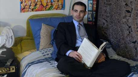 Carl Potak, 28, on his bed in the