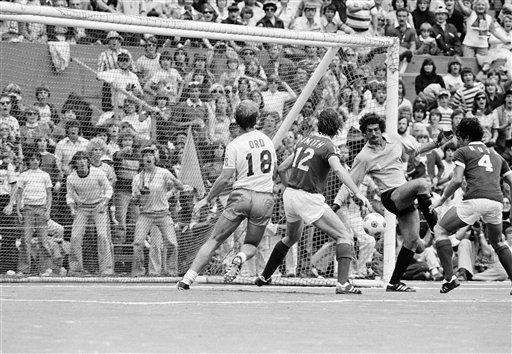 Cosmos' goalie Shep Messing, third from left, blocks