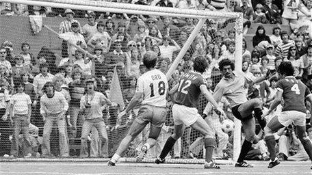 Cosmos' goalie Shep Messing, third from left, blocks